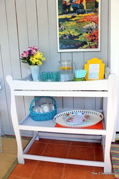 Turn your old changing table into a bar.