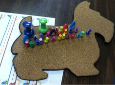 Give the corkboard dog his pushpin shots-fun fine motor activity for kids! From Days of our OT Lives. Pinned by SOS Inc. Resources @sostherapy.