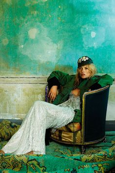 Mario Testino photographed Kate Moss wearing a khaki parka over a sequinned evening dress, with a military cap, in Hope and Glory for the October 2008 issue of Vogue.