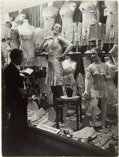 Paris shop window, 1920s - women might have done away with corsets in the Twenties but undergarments such as girdles were still restrictive to get the desired slim, boyish silhouette. -Queens of Vintage