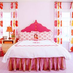 I freakin love this headboard. My 6 year old would go crazy for a room like this. She is not your typical little girl so this borderline kid and pre-teen room is perfect. The orange and the fuchsia are a perfect color scheme. This defiantly gets a place in my dream home. headboard, orang, curtain