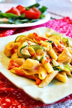 chicken, penne and vegetables in a garlic cream sauce