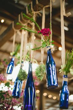 have the bottles...so why not decor, blue glass centerpiece, pink flowers, bottle trees, rustic weddings, wine bottles, blue bottl, wedding centerpieces, outdoor weddings