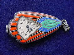 Art Deco enamelled watch/locket/pendant hallmarked for Edinburgh, 1926. There is a recess above the face of this Swiss-movement watch for storing precious objects such as a photo or hair.