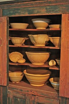 cupboard full of antique yellow ware