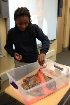 (Dec. 2012) LindenHall.org Members of Mrs. Conlin's Middle School science class took a project on the long-term global affects on our environment to the next level by constructing a working volcano! Above is the volcanic activity in action...