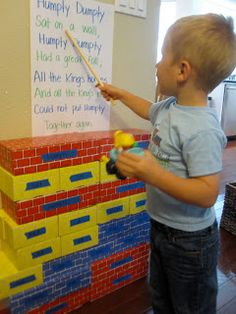 With the kids, write the words from a shared reading on painters tape which is then stuck to blocks.  Build text on the floor and then up and down.