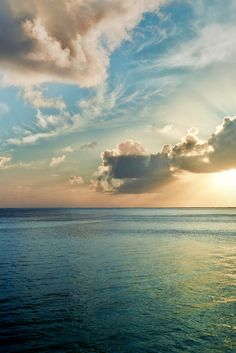 calm ocean, sunset with a few clouds