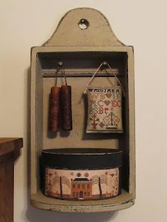 Samplers and Santas - love this little hanging shelf