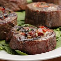 Flank Steak Pinwheels.  Sun-dried tomatoes, spinach, cheese, rolled up in steak.