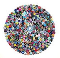 This paper clock is put together using hundreds of hand-rolled magazine paper beads, rhinestones, a quartz clock and an old record. Silver hands keep fine time, and the intense colors will be sure to wake you up when you check on the time