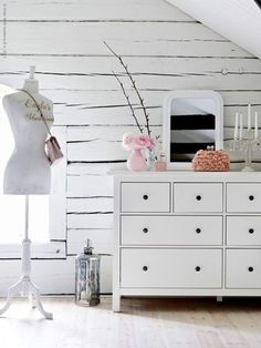 All white room with a pop of soft pink for color. Crisp