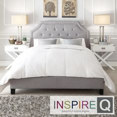 Make a space look glamorous with this grey upholstered bed. The soft linen and tufted headboard will add class and comfort to your bedroom.