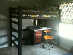 The actual bed my dad made. With Bri's new bedding and desk with desk chair and roman shades I made.-Kate