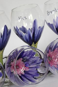 Wedding decor hand painted wine glasses! Custom purple hibiscus wine glasses by Judi Painted. Great for weddings, bridal showers, gifts, and more! $24 each. View and place orders at www.JudiPaintedit.etsy.com or www.JudiPaintedit.com