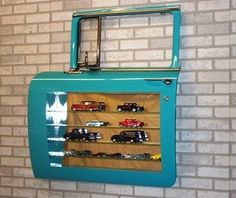 Display cabinet made from 56 Chevy wagon front door