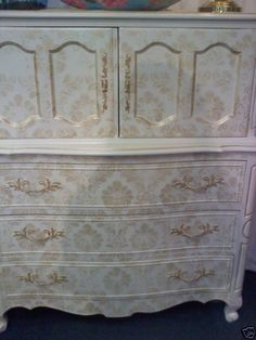 French Provincial style with stenciled gold damask overlay
