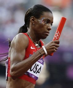 United States' Deedee Trotter competes in a women's 4x400-meter relay heat during the athletics in the Olympic Stadium.