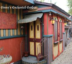 Storage shed decorated to look like a gypsy wagon to fit the theme bohemian outdoor bedroom.