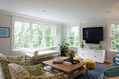 Bright Living Room with great windows, ikat chairs and geometric rug - Bryan Road Home by Nightingale Design