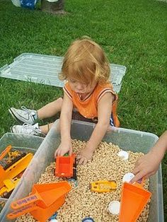 Cheerios in a Sensory Tub! great idea for babies and toddlers who still put everything in their mouth.