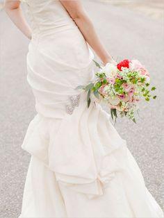 jewel butterfly accessories on wedding dress  via weddingchicks.com/2014/02/10/elegant-valentines-day-ideas/