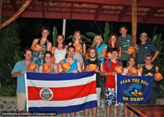 The ENWC in Costa Rica group display the UD and Costa Rican flags with pride