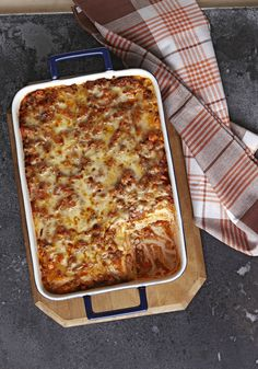 Easy Ravioli Lasagna Bake -- With frozen ravioli and a little TLC (and extra cheese) on your part, this lasagna bake recipe is a very easy way to please the family.