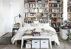When you're tight on space, place the bed in the center and fill the walls with tons of extra storage.