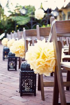 . yellow flowers, aisle decorations, pom poms, flower ball, wedding ideas, hanging flowers, paper flowers, outdoor weddings, chair decorations