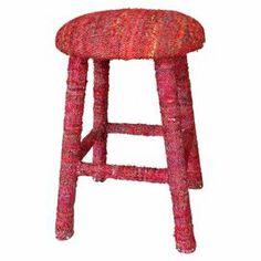 "An eye-catching addition to your kitchen counter or desk, this wood stool is wrapped in red sari silk upholstery. Handmade in India.   Product: StoolConstruction Material: Wood and sari silkColor: RedFeatures: Handmade in IndiaDimensions: 24"" H x 16"" Diameter"