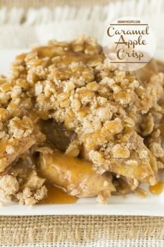 Warm apple crisp made with old fashioned oats, fresh fall apples, spiced perfectly and drizzled with caramel sauce. This recipe features a double layer of oat topping.