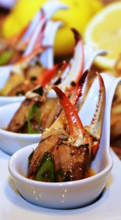 Louisiana Crab Claws Bordelaise - big meaty crab claws swimming in a buttery garlic and green onion sauce with a hit of tang from the dressing and lemon.  My oh my!
