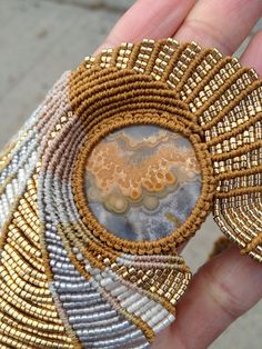One of a kind Freeform Macrame Beaded necklace with Unique Lace Agate Cabochon. $800,00, via Etsy.