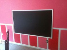 Painted a chalk board straight onto the wall.  Taped off the section for the chalkboard, painted with chalkboard paint and then purchased trim, cut to fit chalk board and framed it out.  (TIP:  Chalkboard paint is just satin finish paint, paint the other walls in the room with satin finish so if the kids get a little chalk happy, it will wash right off!  But dont tell them so they dont do it on purpose! lol)