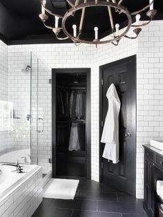 bathroom makeovers, black doors, black bathroom floor tile, master bathrooms, black and white tiles bathroom, black and white bathrooms, black and white bathroom ideas, black and white bathroom floor, subway tiles