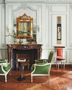 Francophile Fantasy in New York-A pair of 1760s Louis XVI bergères à la reine upholstered in a Prelle silk velvet flanks a 1950s French side table in the living room; the Louis XVI chair is upholstered in a silk from Donghia.