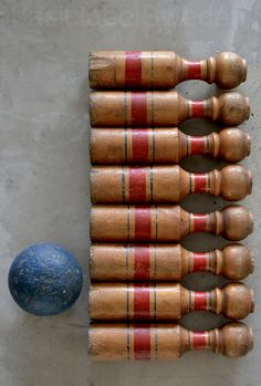 old bowling set; always love the look of red on aged wood