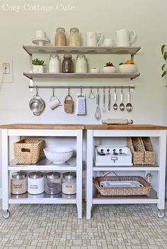LOVE, love, love this whole little space...IKEA kitchen carts, shelves and bar with S hooks, baskets and magazine files from HomeGoods, & basics in glass canisters  {Cozy.Cottage.Cute}
