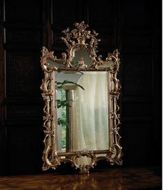 Classic 18th century mirror in antiqued gold finish. Beveled center mirror.