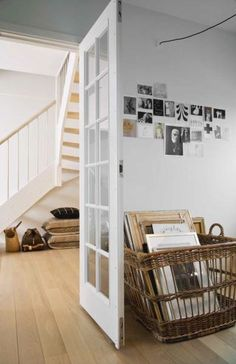 I really like the idea of a huge basket for corralling canvases and frames. plus, pinning up art, corkboard or no!