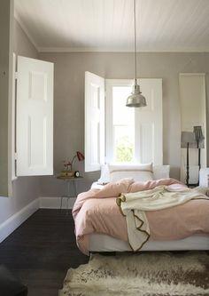 gray walls, white trim, dark floor.