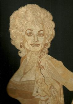 Dolly Parton in rice leaves  Handmade leaf art by museumshop, $199.00   Hollywood star Handmade leaf art  by museumshop,  No color paint or dye added to the natural color of rice straw (Dried leaves of rice plant).  This portrait is not a photo, painting, print but handmade with thousands of tiny pieces of rice straw.  COLLECTIBLE LEAF ART.