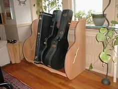 The Studio™ Deluxe Guitar Case Rack in a customer home.