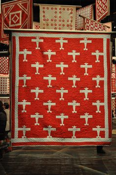 What little boy can pass up an airplane quilt? Sweet red and white vintage quilt.