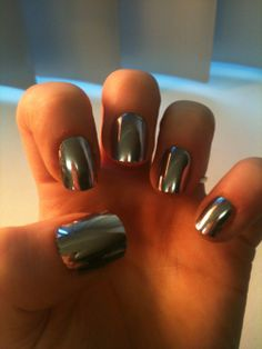This Metallic nail polish available at Sephora adds a stainless steel/mirror effect to your nails. lafemmedoll