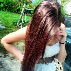 Dark brown hair with cherry cola red highlights More