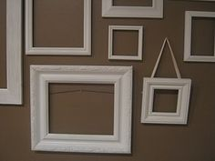 A collage of photo-less frames. Simply gather frames, remove glass and backing, spray paint it the color you prefer, and hang! (updated link)