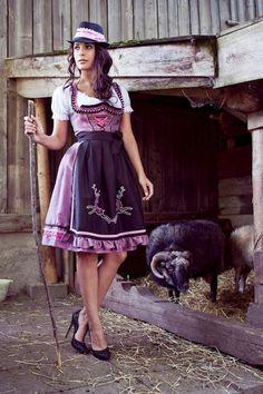 Love the stags on her apron - Mademoiselle Anouk - Herbst/Winter 2012/13. #dirndl #dress #German #Austrian #folk #traditional #costume #Oktoberfest #deer