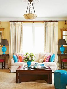 Use pops of color to show your personality in your living space! More living room designs: http://www.bhg.com/rooms/living-room/room-arranging/living-room-designs/?socsrc=bhgpin062113bluelamps=2